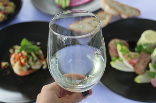 glass of wine with food as background_hyde park place